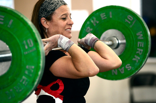 "Rosanne Smario-Allen works on the Squat Clean which is one element of the skill set of one the two olympic weightlifting events the Clean and Jerk at Flatirons CrossFit on Tuesday December 4, 2012.<br /> For more photos go to  <a href=""http://www.dailycamera.com"">http://www.dailycamera.com</a><br /> Photos by Paul Aiken"