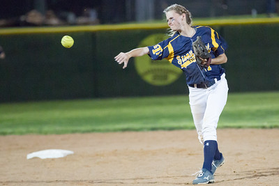 Samantha Laberge throws to first base against Rouse.