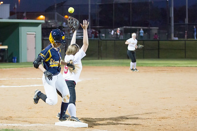 Jade Lassetter (1) beats out a throw to first base against Rouse.