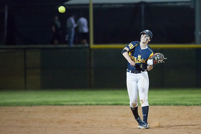 Jade Lassetter throws to first base against Rouse.
