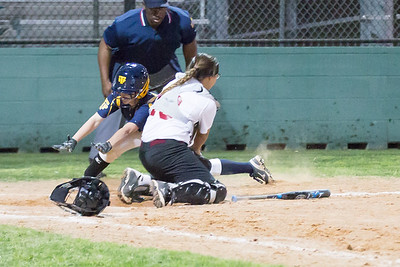Jade Lasseter beat Rouse catcher Ava Bell at home.