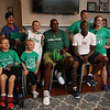 Plotkin family in Groton, Erik and wife Erin Plotkin, right, son Tyler, 14, left, who had brain surgery as an infant, daughter Alisa, 11, and son Gavin, 5, gets a backyard basketball court, with a visit by Boston Celtics' Terry Rozier, seated left, and retired legend Cedric Maxwell, center. At left rear is Arbella Insurance director of corporate communications Maryanne Hailer. (SUN/Julia Malakie)
