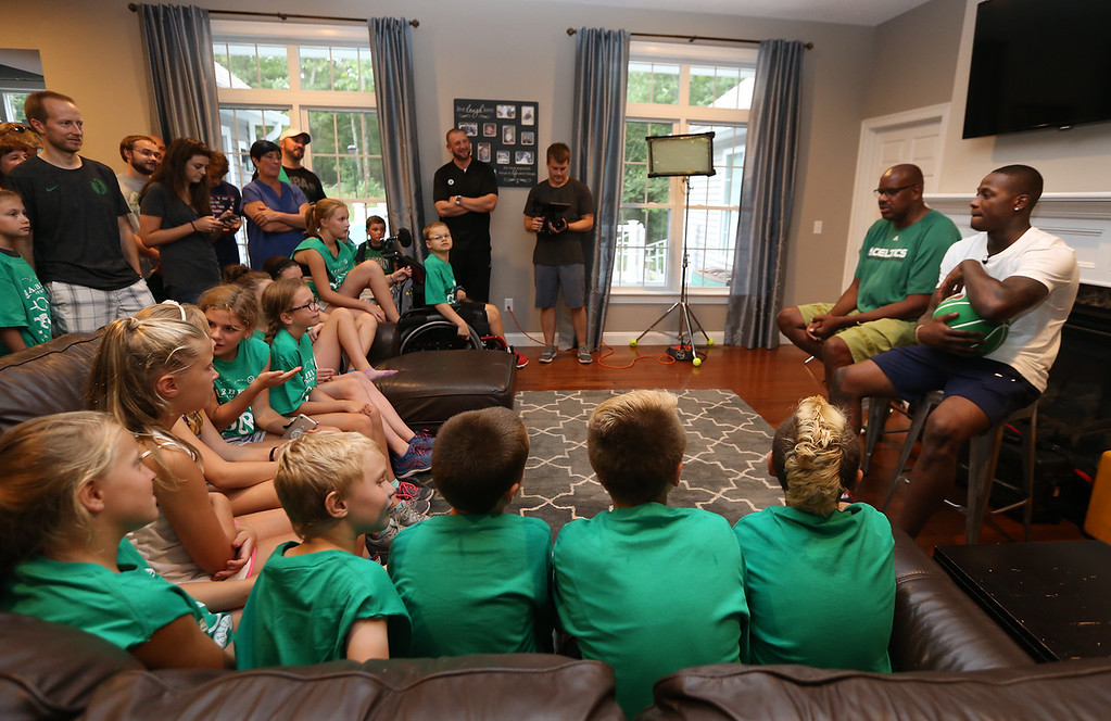 . Plotkin family in Groton gets a backyard basketball court, with a visit by Boston Celtics\' Terry Rozier, right, and retired legend Cedric Maxwell, second from right. (SUN/Julia Malakie)