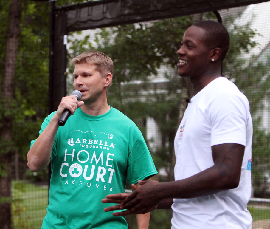 . Plotkin family in Groton gets a backyard basketball court, with a visit by Boston Celtics\' Terry Rozier, and retired legend Cedric Maxwell. Erik Plotkin, left, with Terry Rozier. (SUN/Julia Malakie)