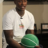 Plotkin family in Groton gets a backyard basketball court, with a visit by Boston Celtics' Terry Rozier, and retired legend Cedric Maxwell. Terry Rozier talks to kids inside due to threatening rain. (SUN/Julia Malakie)