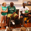 Plotkin family in Groton gets a backyard basketball court, with a visit by Boston Celtics' Terry Rozier, and retired legend Cedric Maxwell. Alisa Plotkin, 11, and Cedric Maxwell listen to Terry Rozier. (SUN/Julia Malakie)