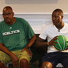 Plotkin family in Groton gets a backyard basketball court, with a visit by Boston Celtics' Terry Rozier, right, and retired legend Cedric Maxwell, left. (SUN/Julia Malakie)
