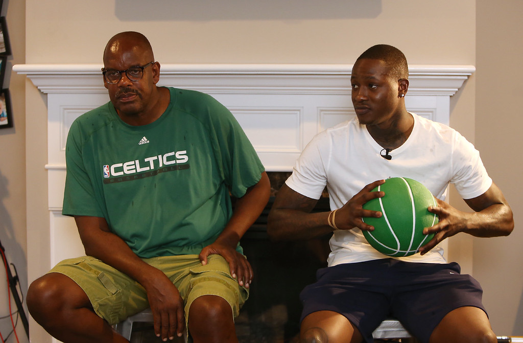 . Plotkin family in Groton gets a backyard basketball court, with a visit by Boston Celtics\' Terry Rozier, right, and retired legend Cedric Maxwell, left. (SUN/Julia Malakie)