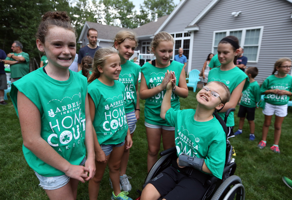. Plotkin family in Groton gets a backyard basketball court, with a visit by Boston Celtics\' Terry Rozier, and retired legend Cedric Maxwell. Clockwise from left, Meghan McElheney, 11, Kristen McLean, 11, Ella Dinsome, 11, Alisa Plotkin, 11, Sarena Kretas, 10, and Tyler Plotkin, 14. (SUN/Julia Malakie)