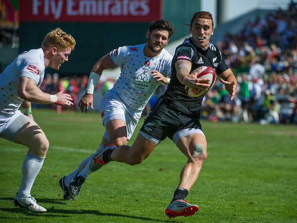 Joe Webber of New Zealand with a show-and-go to score against England in the Cup Quarter Final of the IRB Sevens World Series rugby tournament at the Emirates Airline Dubai Rugby Sevens in Dubai, UAE, on Saturday, Dec. 6th, 2014. Photo by: Stephen Hindley/Sportdxb/Photosport