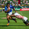 Fautua Otto od Samoa drives for the line in their Pool B match against Japan during the first day of the IRB Sevens World Series rugby tournament at the Emirates Airline Dubai Rugby Sevens in Dubai, UAE, Friday, Dec. 5th, 2014. Photo by: Stephen Hindley/Sportdxb/Photosport