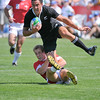03/072009. Rugby World Cup Sevens 2009. Dubai  - New Zealand's  Zar Lawrence attempts to break through the Welsh defence.   Wales knocked NZ out at the quarter finals with a 15-14 victory and went on to claim the World Cup.