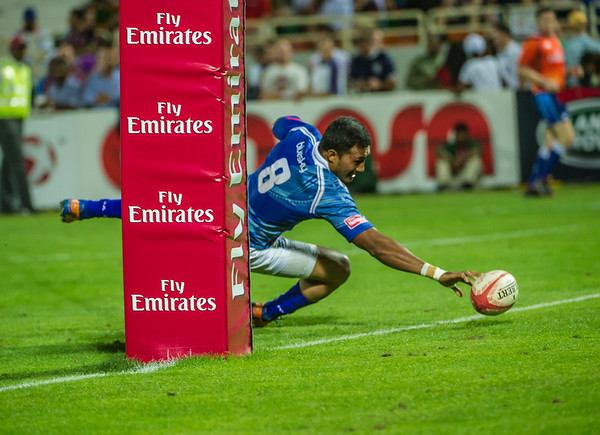 Reupena Levasa of Samoa is awarded the try in the Bowl Final  against France of the IRB Sevens World Series rugby tournament at the Emirates Airline Dubai Rugby Sevens in Dubai, UAE, on Saturday, Dec. 6th, 2014. Photo by: Stephen Hindley/Sportdxb/Photosport