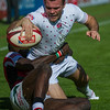 Tom Bowen of England scores against Kenya in their Pool C match during the first day of the IRB Sevens World Series rugby tournament at the Emirates Airline Dubai Rugby Sevens in Dubai, UAE, Friday, Dec. 5th, 2014. Photo by: Stephen Hindley/Sportdxb/Photosport