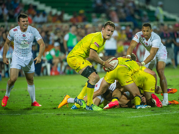 Cameraon Clarke of Australia prepares to clear the ball during the Pool C match against England  the first day of the IRB Sevens World Series rugby tournament at the Emirates Airline Dubai Rugby Sevens in Dubai, UAE, Friday, Dec. 5th, 2014. Photo by: Stephen Hindley/Sportdxb/Photosport
