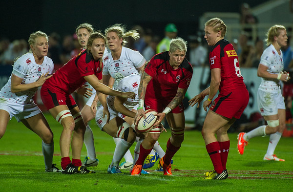 Canada's Jennifer Kish looks to get the pass away in the Pool C match against England during the first day of the IRB Women's Sevens World Series rugby tournament at the Emirates Airline Dubai Rugby Sevens in Dubai, UAE, Thursday, Dec. 4th, 2014. Photo by: Stephen Hindley/Sportdxb/Photosport