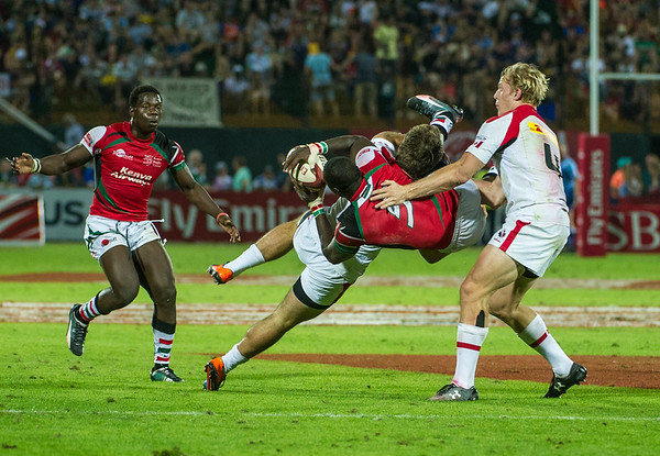 Pat Kay of Canada lays a heavy tackle on Kenya's Dennis Muhanji in the Shield Final between canada and Kenya of the IRB Sevens World Series rugby tournament at the Emirates Airline Dubai Rugby Sevens in Dubai, UAE, on Saturday, Dec. 6th, 2014. Photo by: Stephen Hindley/Sportdxb/Photosport