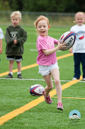 """Young Girl Playing Rugby"""