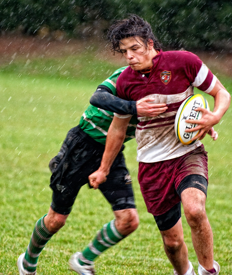 Luke maintains firm pressure on the ball