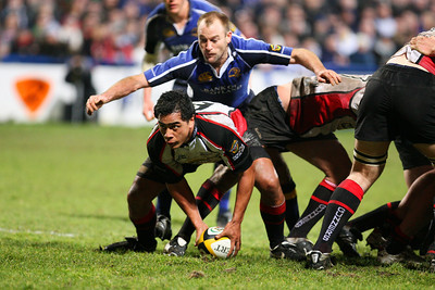 Edinburgh's scrum half, John Senio gets the ball away despite close attention from Leinster's scrum half, Chris Whittaker