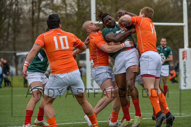 AMSTERDAM, NETHERLANDS MARCH 04: Aderito Esteves of Portugal is tackled by Sep Visser and Dirk Danen of the Netherlands during the Rugby Europe Trophy match between the Netherlands and Portugal at the National Rugby Centre Amsterdam on March 04, 2017 in Amsterdam, Netherlands.