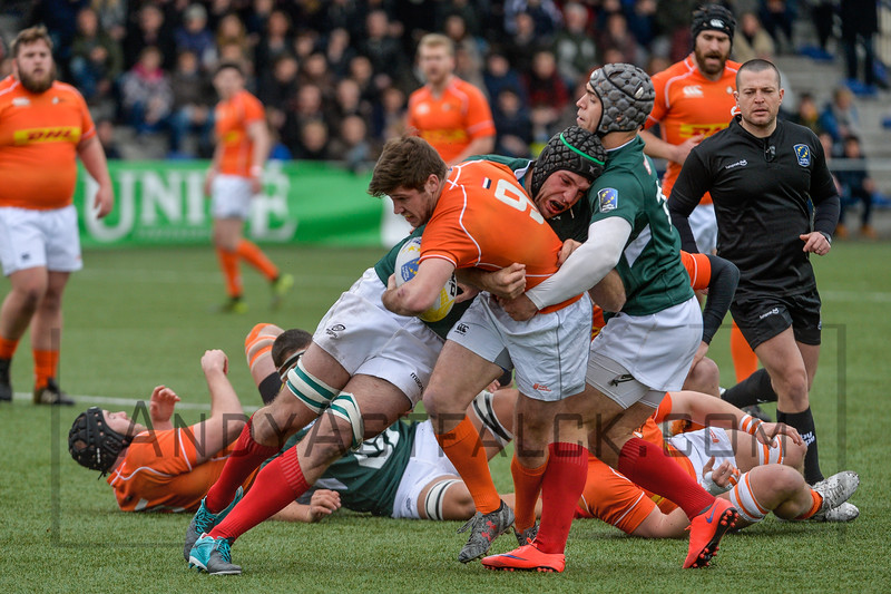 AMSTERDAM, NETHERLANDS MARCH 04: Rik Roovers of the Netherlands is tackled by Fernando Almeida (L) Vasco Ribeiro ® of the Portugal during the Rugby Europe Trophy match between the Netherlands and Portugal at the National Rugby Centre Amsterdam on March 04, 2017 in Amsterdam, Netherlands