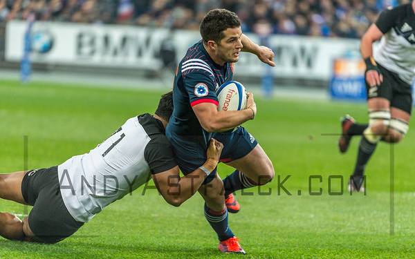 PARIS, FRANCE - NOVEMBER 26: Brice Dulin of France is tackled by Julian Savea of New Zealand during the international friendly test match between France and New Zealand (All Blacks) at Stade de France on November 26, 2016 in Saint-Denis near Paris, France.