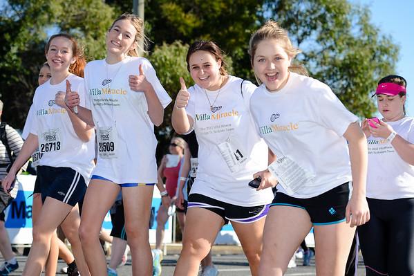 "Villa Miracle Team - 2012 Sunday Mail Suncorp Bridge to Brisbane Fun Run; Sir Leo Hielscher Bridge (Gateway Bridge) to RNA Showgrounds. Camera 1. Photos by Des Thureson:  <a href=""http://disci.smugmug.com"">http://disci.smugmug.com</a>. (Had to include this original crop with the young lady using Social Media :).)"