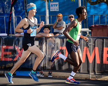 Micael Brownlee, Norbert Petras - 2013 Noosa Men's Asics 5k Bolt Run - Super Saturday at the Noosa Triathlon Multi Sport Festival, Noosa Heads, Sunshine Coast, Queensland, Australia. Camera 1. Photos by Des Thureson - http://disci.smugmug.com