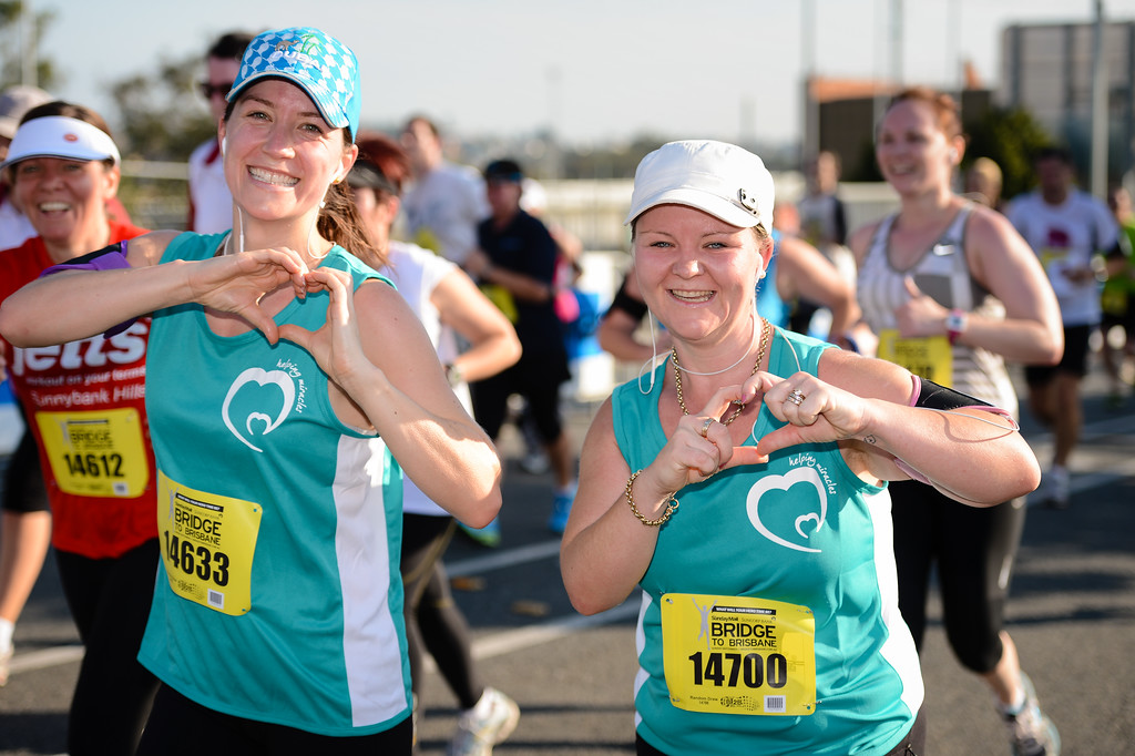 "Nice expressions from the participants - Way to Go! - Helping Miracles - 2013 Sunday Mail Suncorp Bridge to Brisbane Fun Run; Sir Leo Hielscher Bridge (Gateway Bridge) to RNA Showgrounds; 1 September. Camera 1. Photos by Des Thureson:  <a href=""http://disci.smugmug.com"">http://disci.smugmug.com</a>."