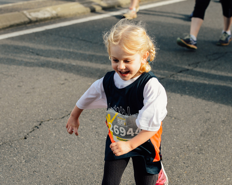 "26944 - Young kid having a blast! - VSCO Film Preset: N - Kodak Gold 100 Warm - 2017 Sunday Mail Brisbane to Brisbane Fun Run, Sunday 27 August; Queensland, Australia. Camera 1. Photos by Des Thureson - <a href=""http://disci.smugmug.com"">http://disci.smugmug.com</a>"