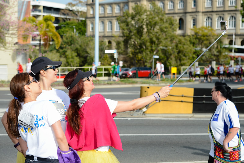 "Selfie, Selfie Stick - Posing for camera at entrance to Story Bridge, Brisbane - 2017 Sunday Mail Brisbane to Brisbane Fun Run, Sunday 27 August; Queensland, Australia. Camera 1. Photos by Des Thureson - <a href=""http://disci.smugmug.com"">http://disci.smugmug.com</a>"