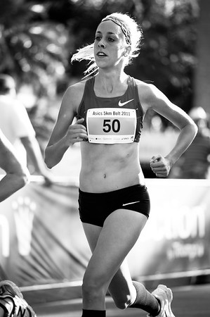 "Alternate Processing: ""x=straight+muggin"" - Women's Winner: Susan KUIJKEN - 2011 Men's & Women's Asics 5k Bolt (Run) - Super Saturday at the Noosa Triathlon Multi Sport Festival, Noosa Heads, Sunshine Coast, Queensland, Australia; 29 October 2011."