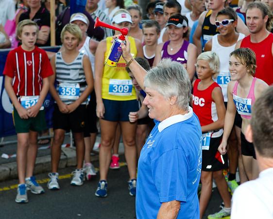 Fake Start for the Photo of Australian Olympic Athlete & Official Race Starter Raylene Boyle - 2012 ASICS Twilight 5km Run; Mooloolaba, Sunshine Coast, Queensland, Australia; 23 March 2012. Photos by Des Thureson - disci.smugmug.com.