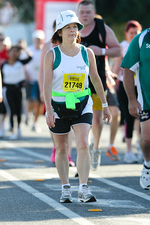 """21749 - 2012 Sunday Mail Suncorp Bridge to Brisbane Fun Run; Sir Leo Hielscher Bridge (Gateway Bridge) to RNA Showgrounds. Camera 2. Photos by Des Thureson:  <a href=""""http://disci.smugmug.com"""">http://disci.smugmug.com</a>. - The images in this gallery have not been edited / cropped. If you order a print, these images will be edited / corrected / cropped before being printed. (If you wish to purchase a download, you can either:  1. Purchase the image 'as is', or 2. Email me and ask me to edit the image prior to your purchase.) Des."""