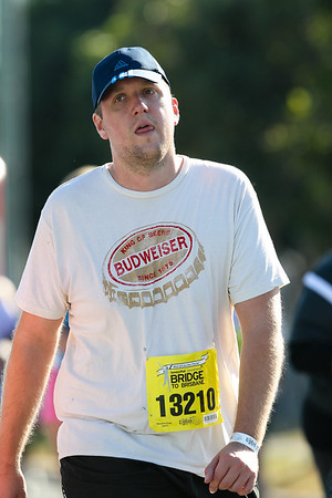 """13210 - 2012 Sunday Mail Suncorp Bridge to Brisbane Fun Run; Sir Leo Hielscher Bridge (Gateway Bridge) to RNA Showgrounds. Camera 2. Photos by Des Thureson:  <a href=""""http://disci.smugmug.com"""">http://disci.smugmug.com</a>. - The images in this gallery have not been edited / cropped. If you order a print, these images will be edited / corrected / cropped before being printed. (If you wish to purchase a download, you can either:  1. Purchase the image 'as is', or 2. Email me and ask me to edit the image prior to your purchase.) Des."""