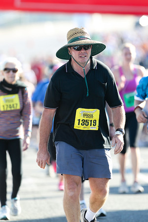 """13519 - 2012 Sunday Mail Suncorp Bridge to Brisbane Fun Run; Sir Leo Hielscher Bridge (Gateway Bridge) to RNA Showgrounds. Camera 2. Photos by Des Thureson:  <a href=""""http://disci.smugmug.com"""">http://disci.smugmug.com</a>. - The images in this gallery have not been edited / cropped. If you order a print, these images will be edited / corrected / cropped before being printed. (If you wish to purchase a download, you can either:  1. Purchase the image 'as is', or 2. Email me and ask me to edit the image prior to your purchase.) Des."""