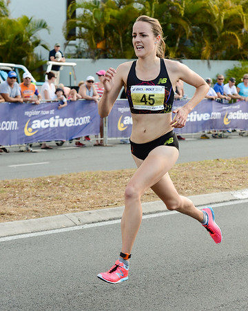 Winner Lucy Van Dalen in full stride - 2012 ASICS Bolt 5km Run (Asics 5k Bolt) - Men & Women; Mooloolaba, Sunshine Coast, Queensland, Australia; 03 November 2012. Photos by Des Thureson