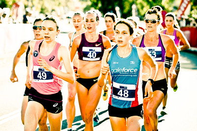 "Alternate Processing: ""Kelco Polar Cream"" - Clare O'BRIEN, Kate Spencer - 2014 ASICS Bolt - 2014 Super Saturday at the Noosa Triathlon Multi Sport Festival, Noosa Heads, Sunshine Coast, Queensland, Australia. Camera 1. Photos by Des Thureson - http://disci.smugmug.com - Camera 1."