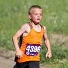 Record-Eagle/Brett A. Sommers Eric Stark competes during Thursday's Record-Eagle 2-Mile Cross Country Classic at Mt. Holiday. Stark finished first in the male 12 and under category with a time of 19 minutes, eight seconds.