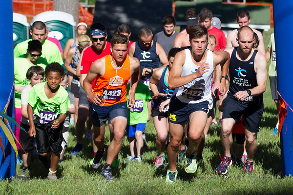 Record-Eagle/Brett A. Sommers Runners take their first step during Thursday's Record-Eagle 2-Mile Cross Country Classic at Mt. Holiday.