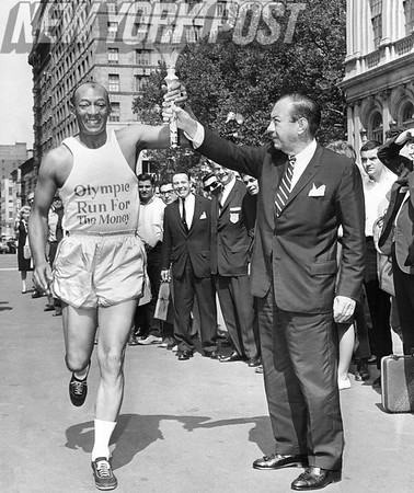 Jesse Owens Gets Torch From Mayor Wagner In Los Angeles Race. 1994.