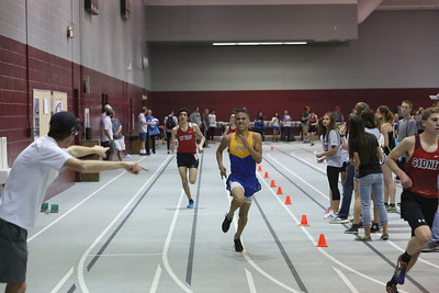 Gering's Xavier Arellano crosses the finish line in the boys 1600 , during the Chadron State High School Invitational at the Nelson Physical Activity Center in Chadron.