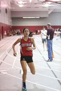 Scotsbluff's Yara Garcia crosses the finish line in the 800 meter run, during the Chadron State High School Invitational at the Nelson Physical Activity Center in Chadron.