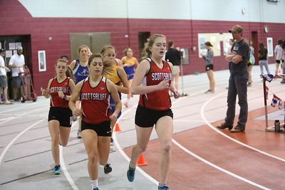 Scottsbluff's Morgan Mickey leads the pack in her heat of the girls 1600 meter run. From left Gering's Nicole Patton Scottsbluff's Kierra Schmidt and Tayler Gipe, during the Chadron State High School Invitational at the Nelson Physical Activity Center in Chadron.