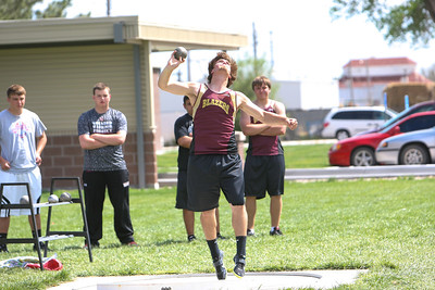 Torrington's Zack Lurz launches the shot put for a personal best and the win. He sent the shot 55. 7