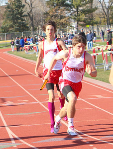 Alliance Invitational-Scottsbluff's Matthew Barraza hands the baton to teammate Traceten Halley. Finishing the 4x400 Relay  in 3:44.90 and placed 3rd.