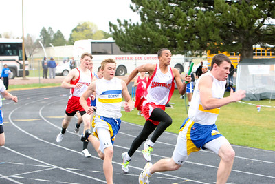 Gerring's Danny O'Boyle take the baton from teamamte Dillon DeMott to win the boys Div I 4 x 100 relay. The Scottsbluff team is Isaiah Castellaw gets the baton from Mathew T. Klein. Gering wins the race.