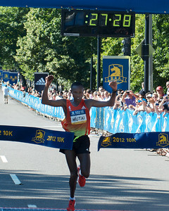 062412, Boston, MA - Runner Geoffrey Mutai of Kenya earns a first place finish in the Second Annual Boston Athletic Assicoation 10K with a final time of 27:29. Herald photo by Ryan Hutton