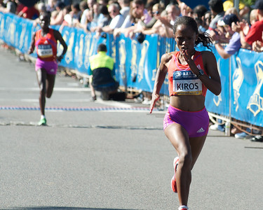 062412, Boston, MA - Runner Aheza Kiros of Ethiopia chugs toward finish line to earn a third place finish as runner Sharon Cherop of Kenya follows in fourth place in the women's division of Second Annual Boston Athletic Assicoation 10K. Herald photo by Ryan Hutton